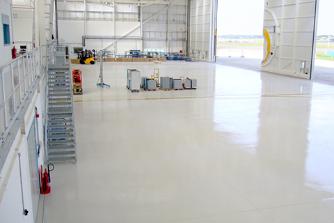 What are the Main Considerations when Selecting a Floor Coating Material for Commercial and Military Aircraft Hangar Facilities?